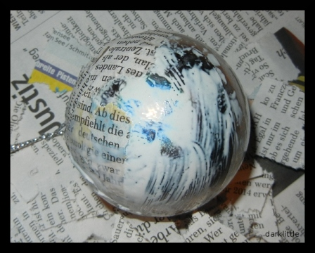 coat the bauble with newspaper snippets
